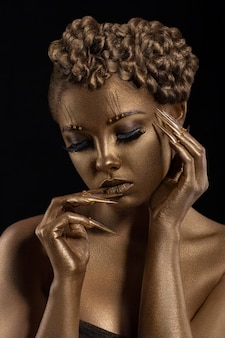 Woman with golden make-up. shiny skin effect jewelry.