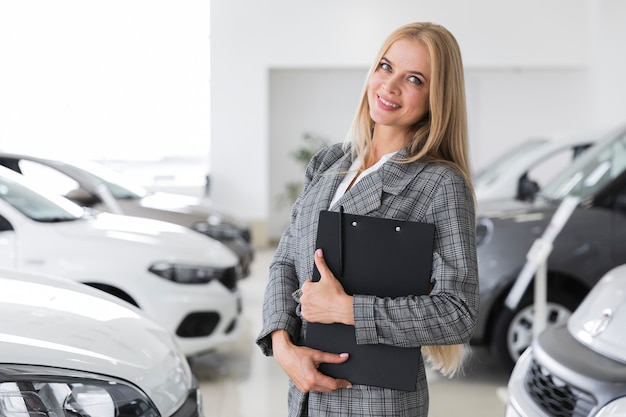 Woman with gray coat at dealership
