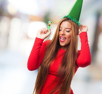 Woman with green hat dancing and smiling
