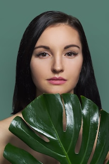 Woman with green leaf, female with natural beauty, no make-up