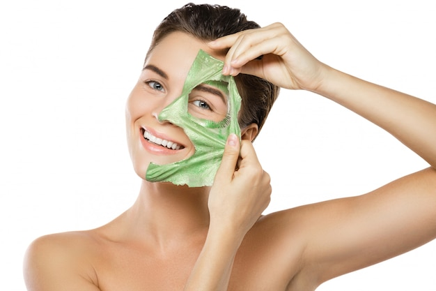 Woman with green peel-off mask on her face