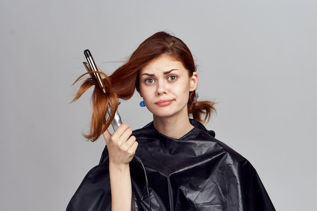Woman with a hair curler in her hands