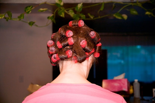 Woman with hair in curlers and net