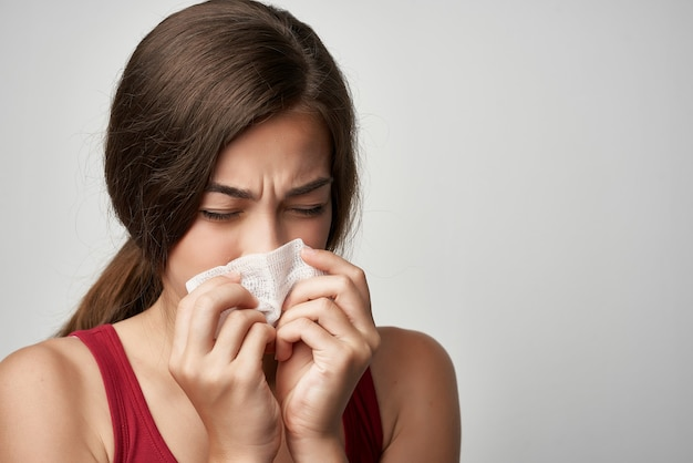 Woman with hammer cold runny nose health problems treatment