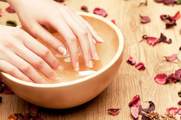 Woman with hands in a bowl in spa Premium Photo