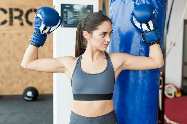Woman with hands in boxing gloves up