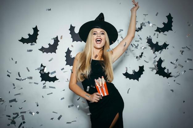 Woman with hatand confetti celebrating
