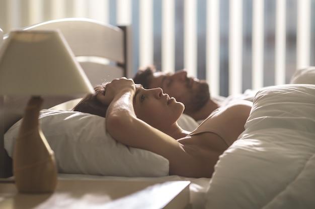The woman with headache lay near the man