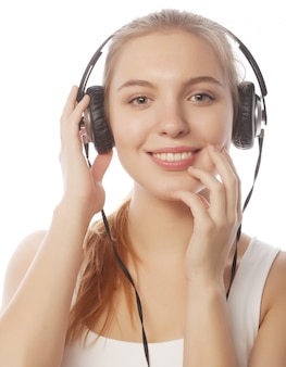 Woman with headphones listening music . music teenager girl isol