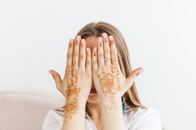 Woman with henna drawing on hands, mahendi