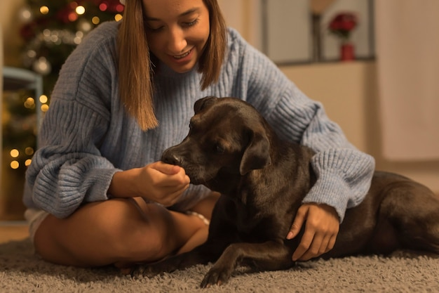 Woman with her dog at christmas
