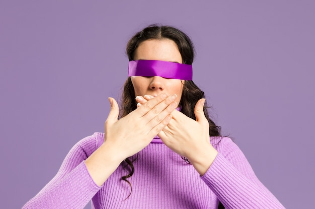 Woman with her eyes covered front view