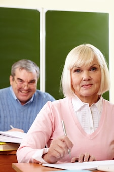 Woman with her husband learning at school
