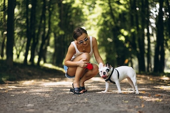 Woman with her pet french bulldog