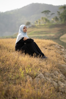 Woman with hijab sitting outdoor