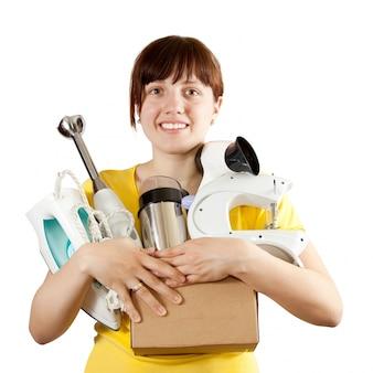 Женщина с бытовой техникой над белым