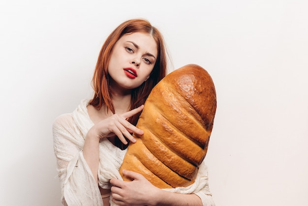 Woman with huge bread, big fresh bread