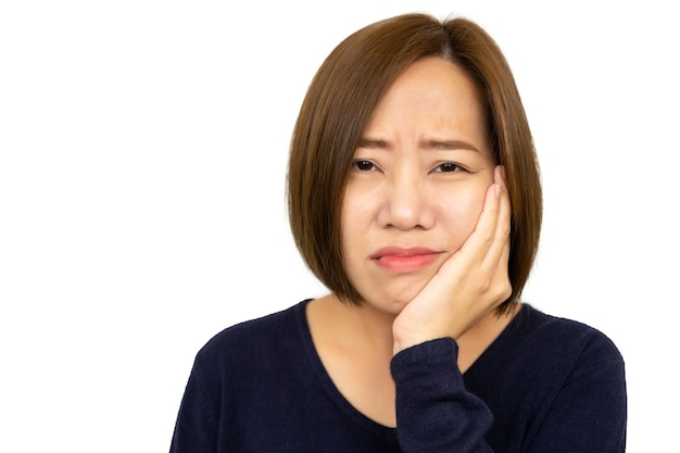 Woman with hypersensitive teeth isolated on white,woman feels pain