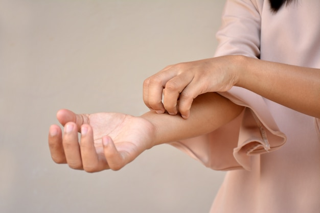 Woman with itchy skin problem Premium Photo