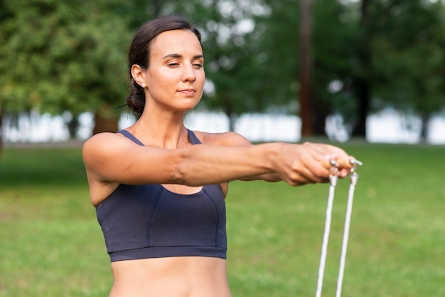 Woman with jumping rope and closed eyes