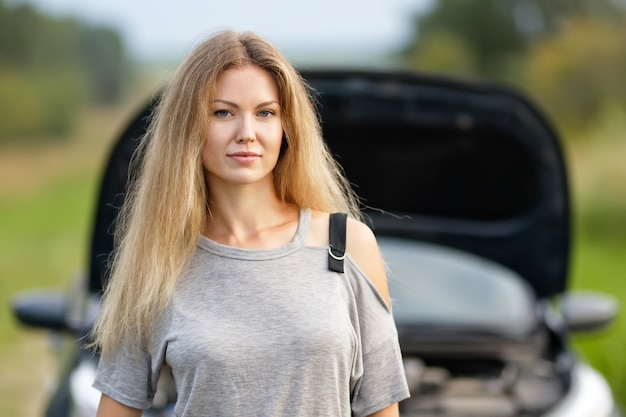 Woman with keys and agreement of car dealership