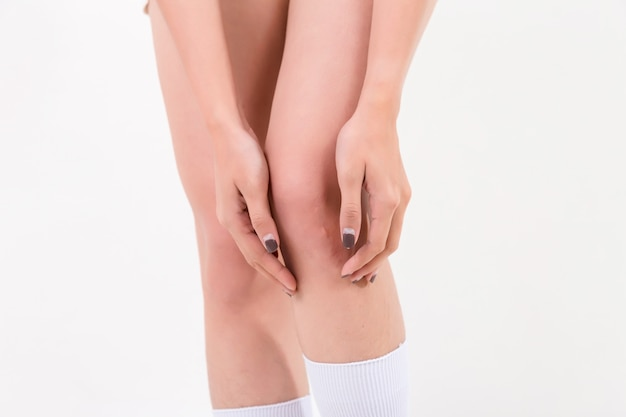 Woman with knee pain. isolated on white background. studio lighting. concept for healthy and medical