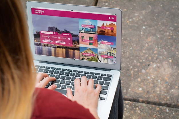 Woman with laptop booking a hotel on website