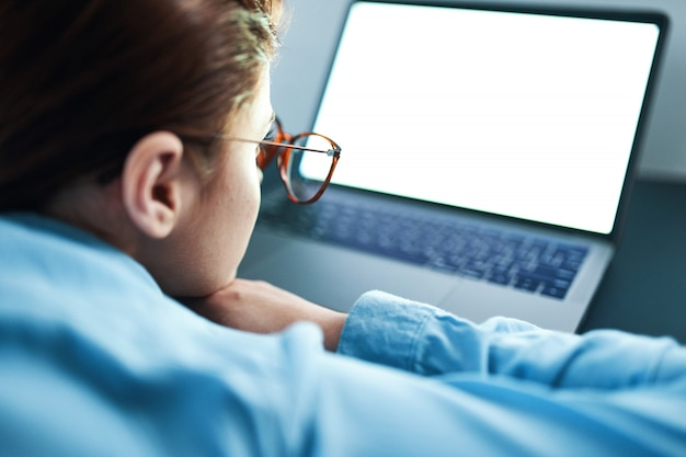 Woman with laptop in glasses sleeps tired