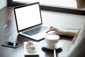 Woman with laptop on a wooden table