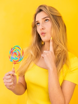 Woman with lollipop thinking