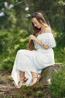 Woman with long hair. lady in a blue dress. girl with untouched nature.