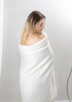 Woman with long hair wiping with towel af bathroom