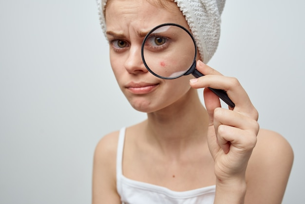 Woman with a magnifying glass in hand hygiene treatment
