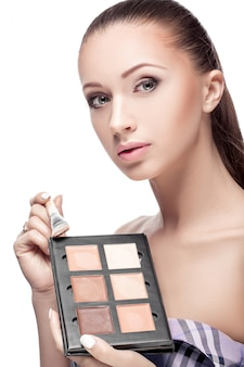 Woman with makeup palette