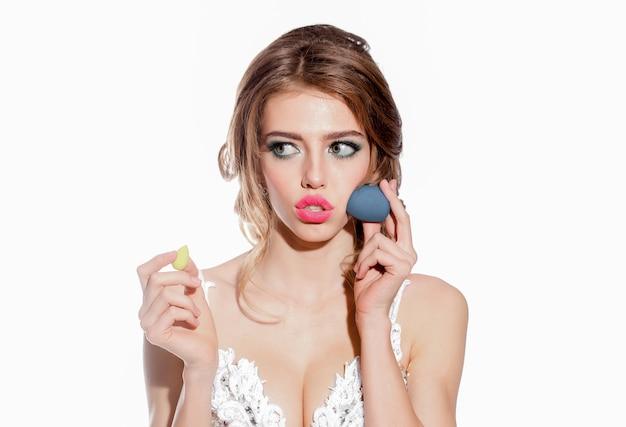 Woman with makeup sponge