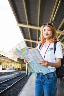Woman with map on platform