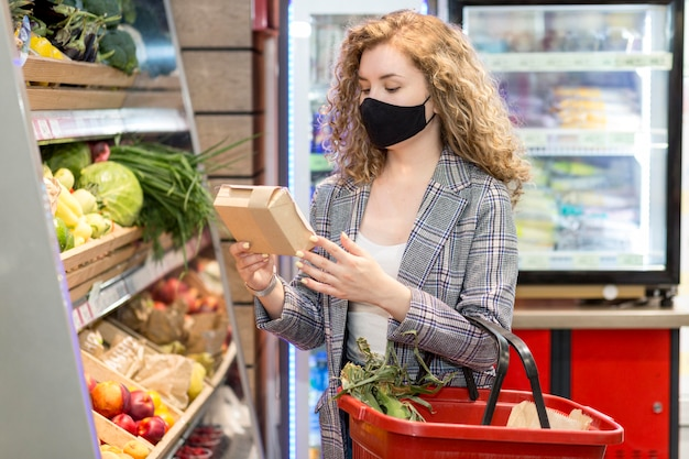 Woman with mask buying grocery