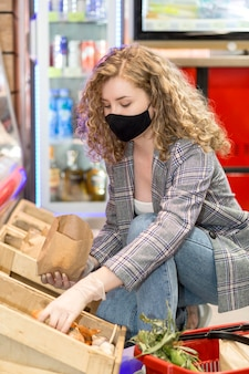 Woman with mask at market shopping grocery