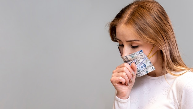 Woman with mask in quarantine coughing copy space