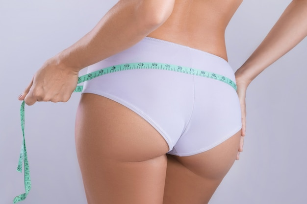 Woman with measure tape