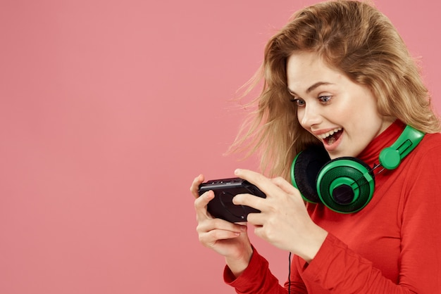 Woman with mobile set-top box headphones playing