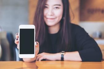 Woman with mockup smart phone