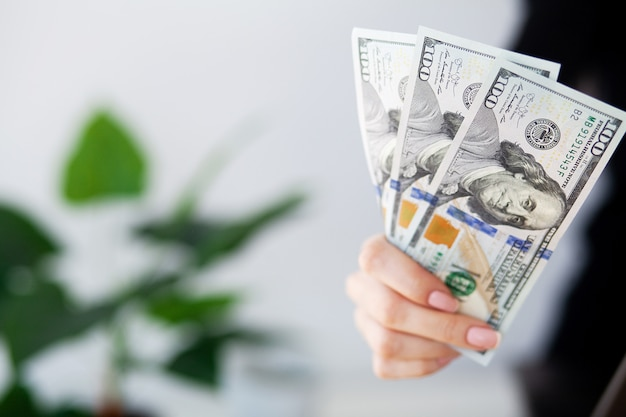Woman with money at workplace. business concept