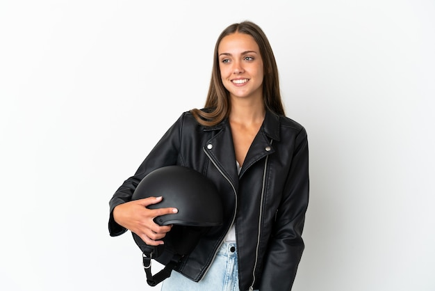 Woman with a motorcycle helmet isolated looking to the side and smiling