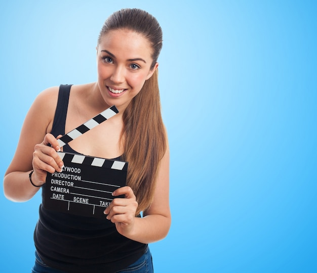 Woman with a movie clapboard