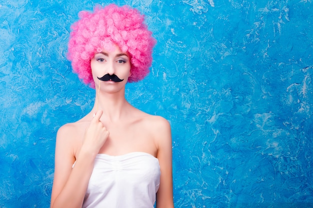 Woman with mustache and pink hair
