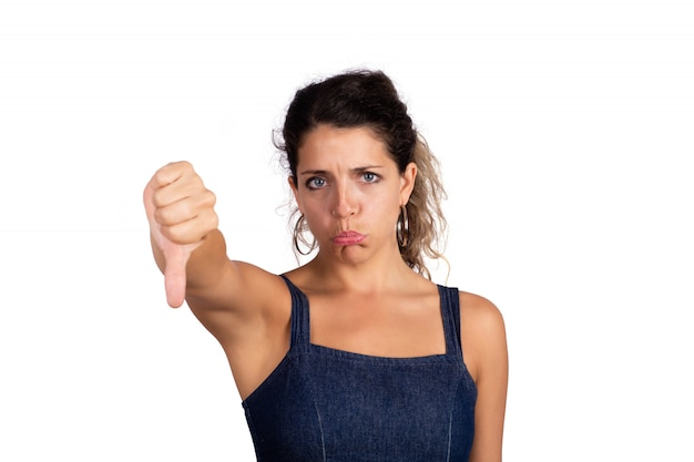 Woman with negative expression and fingers down.