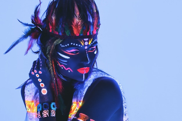 Woman with a neon makeup in ultraviolet light