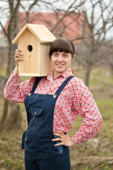 Woman with new birdhouse