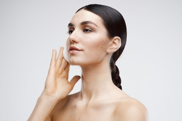 Woman with nude disconnectable cream skin care closeup